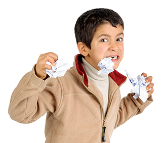 Kid eating paper.
