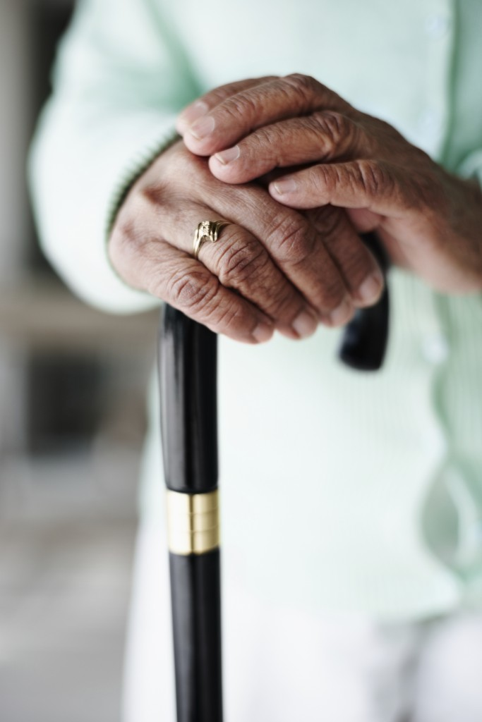 Senior holding a walking stick